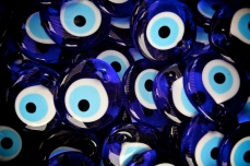 A nazar or evil eye stone, is an amulet that is meant to protect against the evil eye. They are everywhere is Turkey. The evil eye is a look that is able to cause injury or bad luck for the person at whom it is directed.